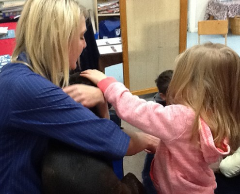 Image of the children enjoying a visit from a PetPET representative
