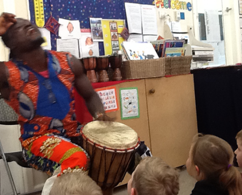 Kindergarten children being taught African drumming