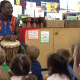 Kindergarten children being taught African drumming