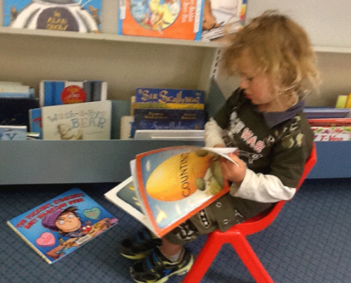 Checking out books to read at the library